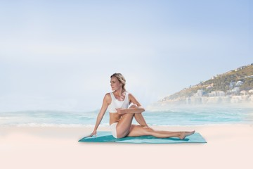 Composite image of gorgeous fit blonde in seated yoga pose