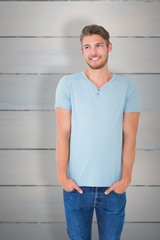 Composite image of young man posing with hands in pockets