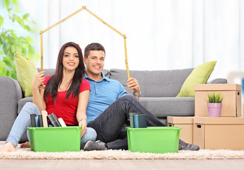 Young couple sitting in a living room