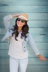 Composite image of brunette in sunglasses