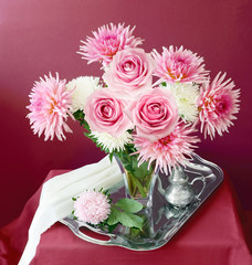 Artistic still life with pink roses and asters