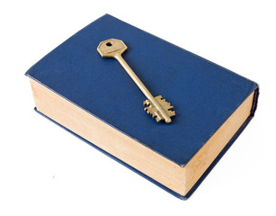 Old book with key isolated on white