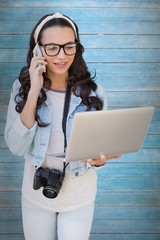 Composite image of pretty brunette with laptop