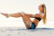 Fit blonde in core balance pilates pose
