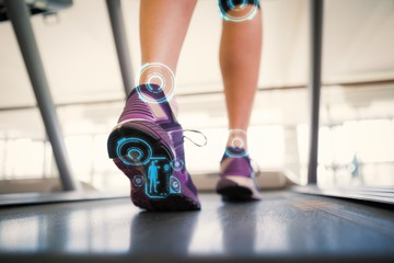 Composite image of woman walking on the treadmill