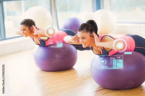 canvas print picture Two fit women exercising on fitness balls