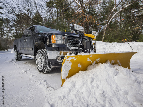 Pickup truck plowing snow - 78430255