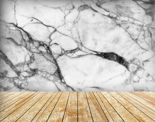 Backdrop marble wall and slabs arranged in perspective.