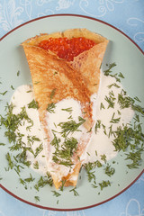 Blini with red caviar and dill
