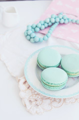 Pastel mint macaroon on light background
