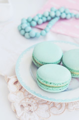 Pastel mint macaroon on light background