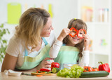 Fototapety mother and her child preparing healthy food and having fun