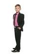 Confident little boy in a black suit