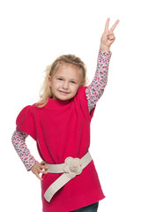 Pretty little girl shows victory sign