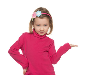 Smiling little girl makes a hand gesture