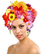 Beautiful young woman with hairstyle from flowers isolated