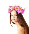Beautiful young woman with wreath of flowers