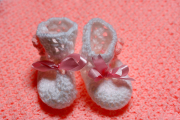 baby little shoes on carpet pink