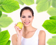 Beautiful young woman with green apple in frame made from