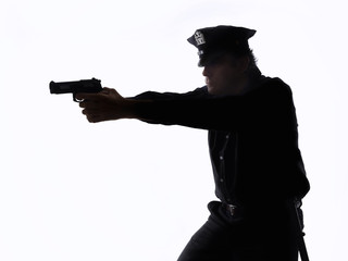 Silhouette of a policeman with the handgun on white background