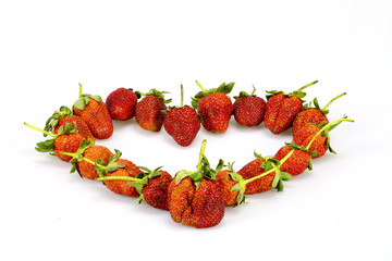 Strawberry  is placed into a heart shape