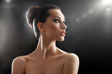 Natural beauty portrait of woman on black background