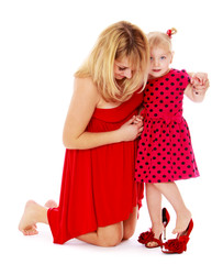Cheerful mother helping her little daughter