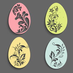 Beautiful floral decorated Easter Eggs set on grey background.