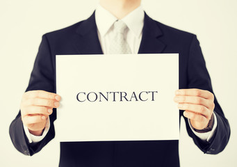man hands holding contract paper