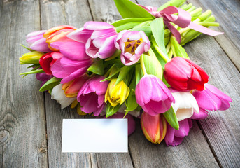 Bouquet of tulips with an empty tag