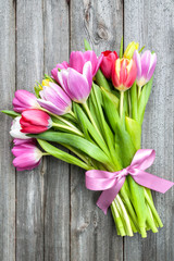 bouquet of spring tulips on old wooden background