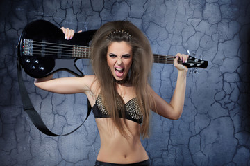 Woman playing music on a bass guitar