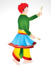 Traditional indian man playing dandiya