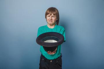 European-looking  boy  of ten years beggar, poor,  asks for mone