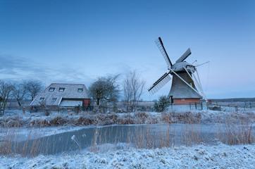 Dutch windmill at winter sunrise