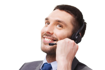 close up of smiling businessman with smartphone