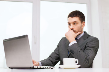 businessman with laptop typing in office