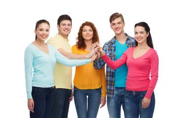 smiling teenagers making high five