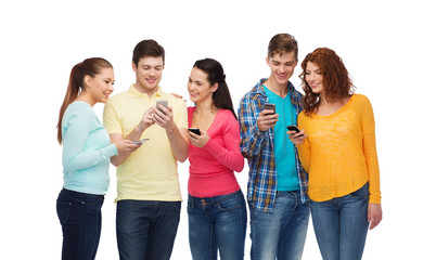 group of smiling teenagers with smartphones