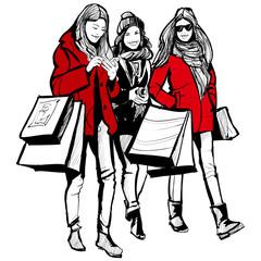 Three young fashionable women shopping
