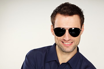 Handsome young man at shirt with sunglasses
