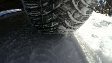Car wheel speeding on winter road