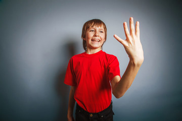 European-looking boy of ten years shows a figure four fingers on