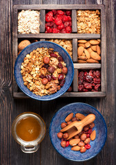 Granola, oatmeal, nuts, dried berries and honey. Healthy food