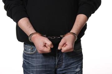 Arrested man handcuffed hands