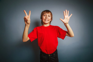 European-looking boy of ten years shows the number seven finger
