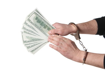 Corruption. hands in handcuffs hold money arrested isolated on w