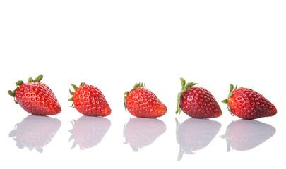Strawberries over white background