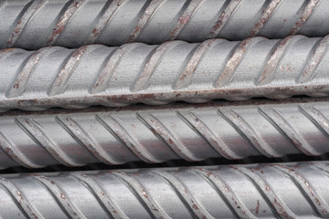 Steel rods or bars used to reinforce concrete