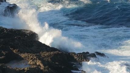 FullHD, Dramatic water waves splashing and crashing against rock
